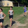 JV Lady Cats Casey Gill and Justine Loyd pass the one mile marker during Thursday's cross country meet at the Perkins Scout Camp in Burkburnett. (Photo courtesy Randy Zamzow)