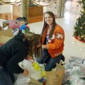 FFCLA members Macy Ridinger and Rachel Wilson sort and pack toys and food collected during a holiday food and Toys for Tots drive at Petrolia High School.