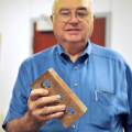 County Judge Kenneth Liggett holds a sample brick made with materials mined in Clay County and presented to commissioners by Triangle Brick Company Monday.